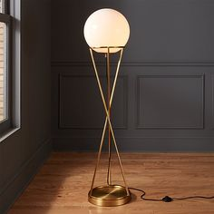 White globe shade hovers atop a minimalist brass base that rises in hourglass form. First designed by Donna Piacenza as a pencil sketch, figural floor lamp casts itself as both sculpture and light fixture. Bronze Floor Lamp, White Floor Lamp, Contemporary Floor Lamps, Modern Floor Lamps, Modern Light Fixtures, Modern Lighting, Lighting Ideas, Lighting Sale, Wall Lighting