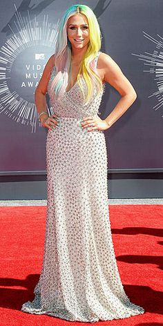 KESHA She ditched the blue hair for her rainbow roots, but surprisingly that's the boldest move the singer made at the VMAs; she kept the rest of her look classic in a blush beaded Johanna Johnson gown that shows off a hint of her décolletage.