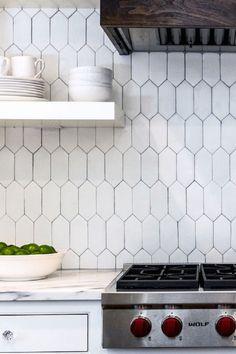 Loving 2016's take on geometric white backsplash tile