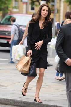 """This picture surfaced from the summer of 2011. Kate wore a black cardigan with her Issa """"Cross Front Dress"""" with while carrying her Mulberry """"Push Polly Lock"""" purse and wearing a pair of Stuart Weitzman """"Conchita"""" sandals."""