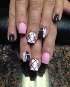 Baby pink, white and black nail polish combination. Arranged to form a plaid nail art design, the nails are also painted with matte white and baby pink colors.