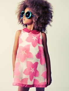 Kenza wanted to be bigger, so her hair was, and her glasses. And the print of her dress.