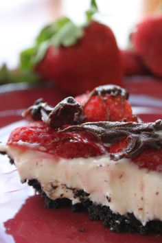 Chocolate Covered Strawberry Bars~T~ These are amazing.The crust is crushed oreos and melted butter. The filling is cream cheese, powdered sugar, cream and vanilla. Topped with chopped strawberries and drizzled with melted chocolate chips. Refrigerate. No baking. Perfect for a hot summer day.