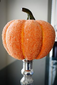 Cover a pumpkin with glue and epsom salt for a more glamorous look with some added sparkle.