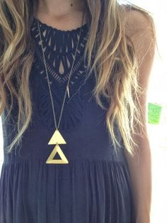 This whole look is perfect. The cut outs on the dress, the gold triangle necklace, and the long loose waves.