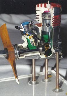 Cutaway model RC aeroplane engine mounted on display stand