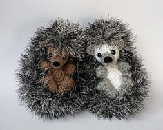 """Almost but not quite rolled into a ball, these hedgies are a bit shy but also interested in making new friends. About 6"""" long, they fit nicely in a hand and since the eyelash yarn creates a soft fabric, they may be loosely stuffed to make them especially soft and squishy. Working with eyelash yarn can be difficult, but I tried to make it as stress free as possible: after the first round, you won't need to count stitches while you work with the fuzzy yarn. The pattern contains instructions…"""