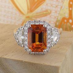 Emerald cut Orange Sapphire with Diamond Shields in 18K White Gold. www.zomacolor.com