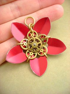 Gearmaille Flower by =monsterkookies on deviantART - Interesting use of watch gears with chainmaille