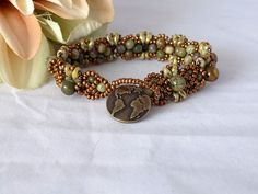 Earth Bracelet Green Gemstone Bracelet Rhyolite Beaded Bracelet Seed Bead Bracelet Gemstone Jewelry Rhyolite Jewelry This gorgeous hand sewn bracelet is perfect for the Fall, Winter Season. A great gift for a teacher. Handmade Jewelry Bracelets, Seed Bead Bracelets, Gemstone Jewelry, Beaded Jewelry, Winter Season, Fall Winter, Green Gemstones, Green Cream, Colorful Bracelets