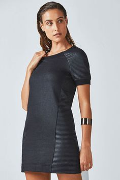 Our matte-finish mini dress is a shining example of throw-on-and-go style. Keep cozy in its soft quilted fabric and relaxed fit.