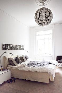 Credit: Heidi Lerkenfeldt/Linnea Press In the master bedroom, muted shades rule. For similar oak wood flooring, try