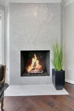 Floor to ceiling marble slab fireplace. Transitional style home in Southlake, TX. 1445 Bent Creek Drive, Southlake, TX.