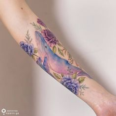 watercolor whale family in flower garden tattoo by @tattooist_silo