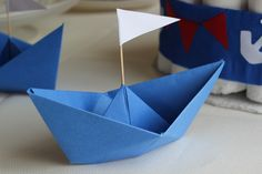 #Nautical #Baby #Shower #Cheap #DIY #Origami Blue paper craft sailing boats with cocktail stick sail.