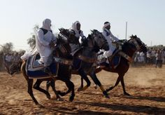 Horsemen wearing traditional Libyan clothes ride their horses at a wedding in Sauq Al-Sibet, about 45 km (28 miles) south of the capital of Tripoli. (Reuters)