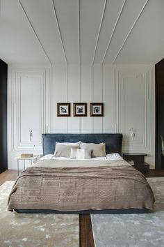 Oh!dessa Apartment by 2Bgroup // refined elegant bedroom. Velvet upholstered bed, two rugs, intricate wall panelling, white walls