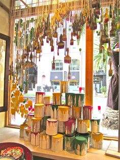 Anthropologie window, Santana Row instead of paintbrushes hang pegs or bridges. Original #window #display!