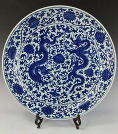 "MASSIVE and VERY FINE Chinese Ming blue and white double dragons charger. The underside left unglazed. Mark on exterior rim, six blue script character, enclosed by blue rectangular frame, JiaJing Reign Period of Great Ming. 4-1/8"" H x 22-1/2"" D"