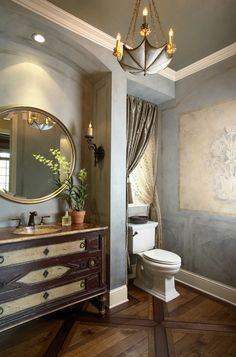 Light fixture, curtains, vanity that looks like a piece of furniture and the painting on the wall