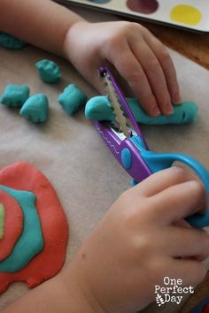 Learning to use scissors with play dough- so much easier than paper (and more fun)