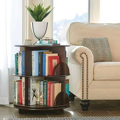 Keep books organized with this rotating bi-level bookcase. Holds twice as many books as traditional bookshelves. Order now from Hammacher Schlemmer. Round Bookshelf, Bookshelf Table, Bookshelf Design, Hammacher Schlemmer, Gold Desk Chair, Desk Chairs, Traditional Bookshelves, Revolving Bookcase, Sectional Sofa With Recliner