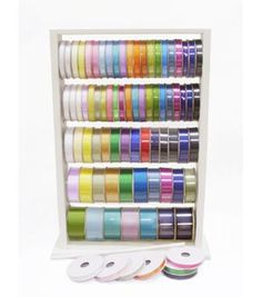 The Ribbon Ladder is designed to hold numerous spools of various sizes. This wall mountable craft storage unit can be used to arrange ribbons in attractive patterns. Place the reels of ribbons on six