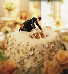 Oldie and always a favorite cake topper....HA HA HA!!#TooFunny  #BrideFellIntoTheWeddingCakeSinkHole