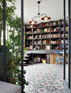 Amazing bookshelves, what a lovely room. Those tiles are beautiful.