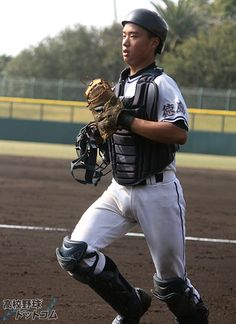Japanese baseball player in catchers position with vest