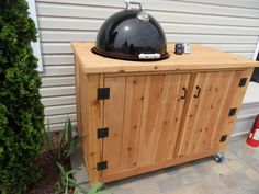 Weber WSM Smoker enclosuregreat idea Going to extend this another section so I can drop in my Weber kettle on the opposite end Grill Table, Grill Cart, Smoker Stand, Weber Bbq, Weber Grills, Bbq Shed, Diy Smoker, Outdoor Bbq Kitchen, Outside Grill