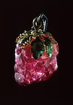 THE ROMANOVS JEWELRY ~ TURMALIN pink, gold, enamel 4 x 2.7 x 2.3 cm. Rare beauty and color of stone weighing about 255 carats, probably brought from Burma, unusual faceted shape of the bunch. Tourmaline was presented to the Empress Catherine II by the Swedish king Gustav III in 1777.