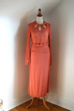 """Coral rayon knit two-piece dress (skirt and sweater) with robe belt, probably American, c. 1930's. Label: """"Knit Craft"""""""