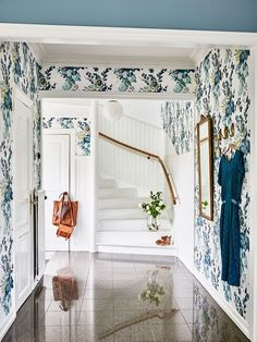 Kristin Lagerqvist's blue and white wallpapered entryway | Swedish house tour via coco kelley
