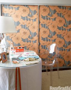 Wallpaper your sliding closet doors! You can often turn them around on the track so the mirror faces inside.