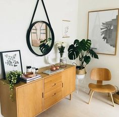 Warm tones mixed with simple decor and greenery in a Scandinavian Style Bedroom