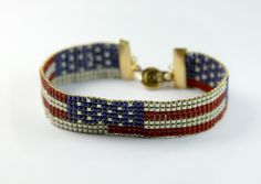Celebrate America with an American treasure. Same Sky honors trailblazing astronaut Buzz Aldrin with a sparkling stars-and-stripes unisex bracelet. Made with d