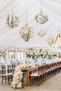30 Summer Wedding Trends Ideas ❤️ summer wedding trends reception under the tent with tall centerpieces white flower table runner and hanging geometry candles with greenry lenamirisola #weddingforward #wedding #bride #weddingdecor #summerweddingtrends