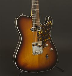 Asher T Deluxe Guitar with top and back binding and hand cut tortoise shell pick guard