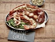 The Main Event - Maine Grill: Whole split lobster grilled over an open flame, topped with homemade basil butter and Old Bay® Seasoning paired with bacon wrapped shrimp and wrapped scallops.  #JoesCrabShack #JoesMaineEvent #MaineGrill #Grilled #Lobster #Bacon #Scallops #Shrimp