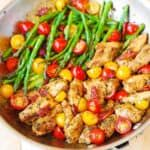 Jump to Recipe Print RecipeOne-Pan Pesto Chicken and Veggies – boneless, skinless chicken thighs cooked with sun-dried tomatoes, asparagus, cherry tomatoes in a delicious basil pesto sauce. Everything is done in one pan, 30 minutes recipe from start to finish! Chicken deliciously smothered with basil pesto sauce and served along delicious vegetables. Healthy, gluten free,...Read More
