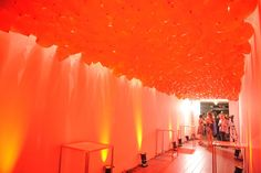 Organizers created a red balloon canopy in the hallway leading to the patio. Photo: George Pimentel
