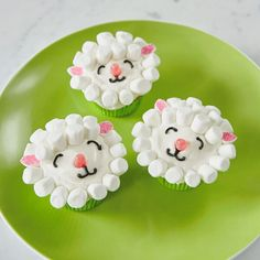 Step-by-step tutorials to make three cute and easy Easter cupcakes: a bunny with pink ears, a fluffy lamb, and a hen in an adorable Easter grass nest. Yum!