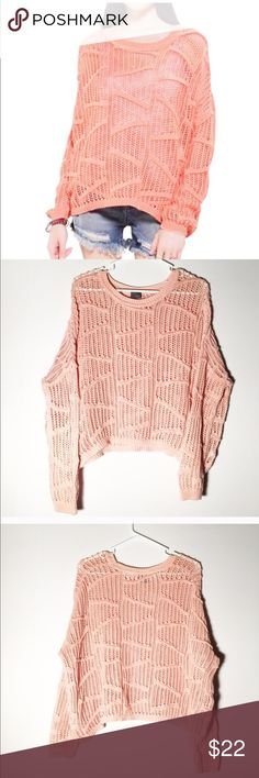 Sparkle and fade open knot top Gorgeous sweater from urban outfitters! Color is a salmon pink! Size medium! Very cute and unique! Make an offer I always accept or counter! Urban Outfitters Tops Tees - Long Sleeve