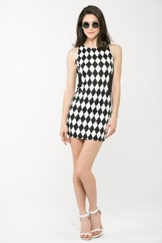 This black and white dress is definitely a statement piece with an eye catching diamond pattern that will turn heads. Check it out at www.cicihot.com #stripes #bodycon #clubwear #fashionista #fashion #welovefashion #cicihot
