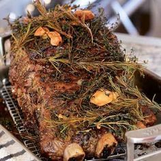 A luxurious centerpiece for a holiday menu, this three-bone prime-rib roast gets heaped with a big pile of smashed garlic, butter, and fresh herbs, then slow-cooked it in a low oven for at least two hours, until the meat becomes meltingly tender, and the herbs and garlic infuse it through and through. Need more ideas for an elegant Christmas dinner roast? Read our Guide to Buying and Carving Prime Rib (before you hit the meat market) and check out our Guide to Christmas Dinner where you'...