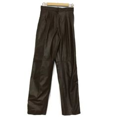 "Comint Brown Leather Pleated Front Pants Comint Size 7 8 Brown Leather Pants Pleated Waist Made in Argentina   Measured Laying Flat   Waist - 13.5"" Inseam - 30"" Rise - 13"" Length - 42"" Vintage Pants"