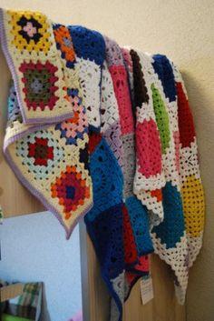 Granny square blanket, see yell9w.  Lovely crochet blankets from StudioSoil