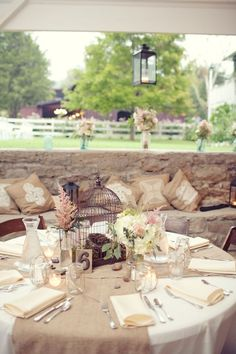 Soft colors, burlap and bird cages! Can't think of more beautiful wedding reception table decor! By far my favorite table setup
