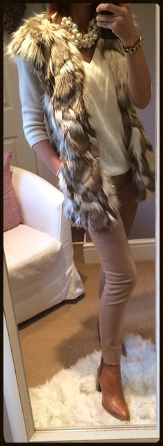 Faux fur gilet, with tan cigarette trousers and ankle boots, statement pearls & a cream jumper.